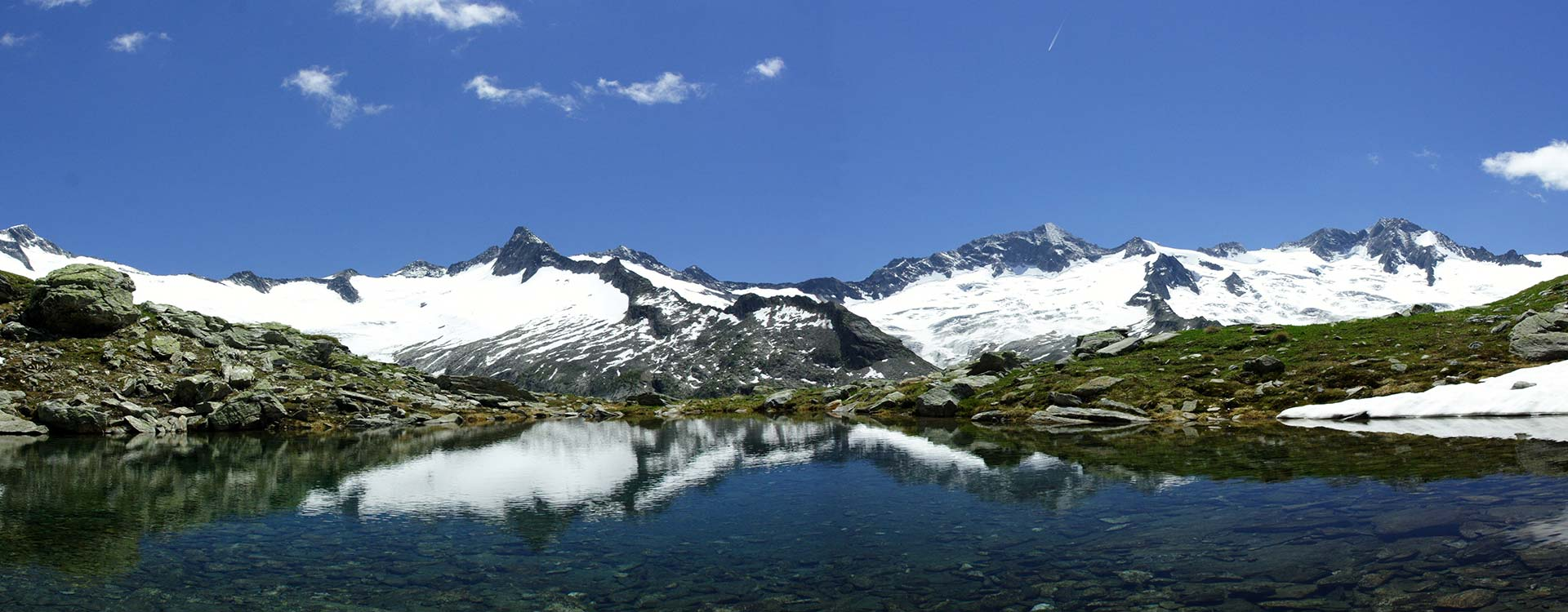 crystal clear Mountain Lakes at the Foot of glaciated Peaks